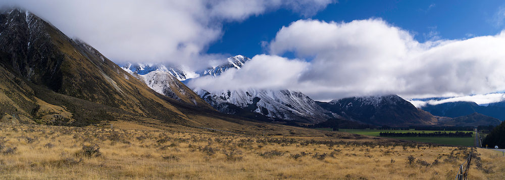 Panoramic view of the Black Range enveloped in clouds, along the West Coast Road, Highway 73, on the way to Arthur's Pass, New Zealand.