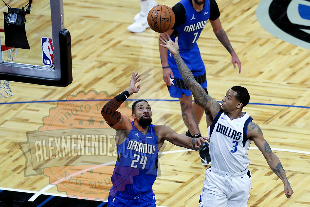 ORLANDO, FL - MARCH 01: Trey Burke #3 of the Dallas Mavericks shoots over Khem Birch #24 of the Orlando Magic during the second half at Amway Center on March 1, 2021 in Orlando, Florida. NOTE TO USER: User expressly acknowledges and agrees that, by downloading and or using this photograph, User is consenting to the terms and conditions of the Getty Images License Agreement. (Photo by Alex Menendez/Getty Images)*** Local Caption *** Trey Burke; Khem Birch
