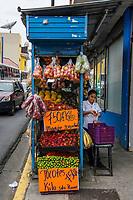 A street vendor sells fruit in central San Jose, Costa Rica