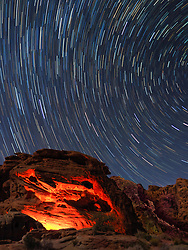 United States, Nevada, Valley of Fire State Park, star trails and campfire