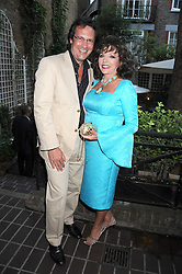 PERCY GIBSON and JOAN COLLINS at a private view of work by Sacha Newley entitled 'Blessed Curse' in association with the Catto Gallery held at the Arts Club, Dover Street, London W1 on 2nd July 2008.<br /><br />NON EXCLUSIVE - WORLD RIGHTS