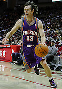 January 31, 2010; Houston, TX, USA; Phoenix Suns guard Steve Nash (13) drives against the Houston Rockets in the first quarter at the Toyota Center. Mandatory Credit: Thomas Campbell-US PRESSWIRE