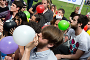 London August 1st 2015 Nitrous Oxide Parliament Square, protest against the proposed Psychoactive Substances Bill. Participants inhale the gas.