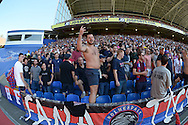 Crystal Palace fan gesturing to camera during the half time break. Barclays Premier league match, Crystal Palace v Aston Villa at Selhurst Park in London on Saturday 22nd August 2015.<br /> pic by John Patrick Fletcher, Andrew Orchard sports photography.