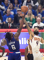 October 21, 2017 - Los Angeles, California, U.S - DeAndre Jordan #6 of the Los Angeles Clippers wins the tip off against Tyson Chandler #4 of the Phoenix Suns during their first season game on Saturday October 21, 2017 at the Staples Center in Los Angeles, California. Clippers defeat Suns, 130-88. (Credit Image: © Prensa Internacional via ZUMA Wire)