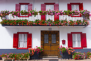 Typical Basque townhouse with geraniums in flower box in town of Oroz Betelu in Navarre, Northern Spain