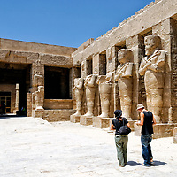 Luxor. Egypt. Theatrical porticoed courtyard with Osiris columns in the Temple of Ramses III at the Temple of Amun in Karnak.
