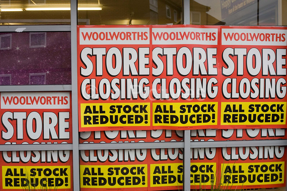 'Store Closing, All Stock Reduced' posters stuck to the window of a closing Woolworths shop in the town of Nailsea, Nth Somerset. In its 100th year, the iconic high street chain of affordable goods has welcomed generations of shoppers since its first outlet opened in 1909 In a period of financial turmoil when recession followed the credit crunch, Woolworths went into administration in November 2008 with debts of £385m Pounds. Its 815 nationwide outlets were forced to close and its 27,000 workers laid off. Around a recession-bled Britain, high-street businesses have been going bust in their thousands. Britain has now endured eight recessions since the Second World War. No two recessions are alike, and that applies to the current slowdown also. It has been caused by a shock to the availability of credit, a massive build up of debt.