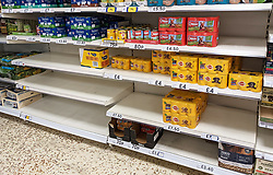 © Licensed to London News Pictures 23/07/2021. Sidcup, UK. Empty shelves in the dog food aisle at Sidcup Tesco in South East London. Shoppers continue to seeing a shortages in supermarkets today as supplies have been hit by staff being forced to self-isolate. Photo credit:LNP