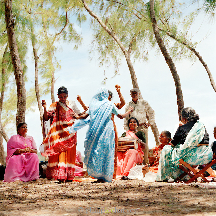 Indian dancers on a beach in Mauritius