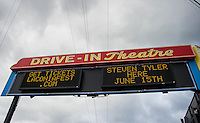 The Weirs Beach Theater marquee flashes the names of headliners including Steven Tyler coming to Laconia Fest during Motorcycle Week starting this weekend.  (Karen Bobotas/for the Laconia Daily Sun)