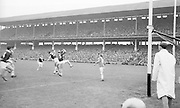 Player attempts to clear ball during the All Ireland Senior Football Championship Final Galway v Meath in Croke Park on the 25th September 1966. Galway 1-10 Meath 0-7.