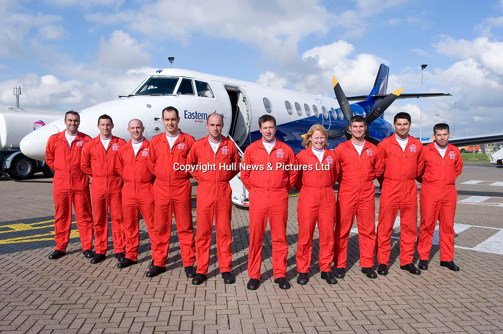 4 October 2010: The Red Arrows at Humberside Airport after they were flown back from Scotland by Eastern Airways following their sponsored scooter ride. Pictured is squadron leader Ben Murphy (centre) with (l-r) Graham Duff, Pablo O'Grady, Mike Ling, Dave Davies, Ben Plank, Kirsty Moore, Zane Sennett, David Montenegro, and Simon Rea..Picture:Sean Spencer/Hull News & Pictures 01482 210267/07976 433960.High resolution picture library at http://www.hullnews.co.uk.©Sean Spencer/Hull News & Pictures Ltd.