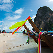 Longtail boats on Phra Nang Beach near Railay in Krabi, Thailand