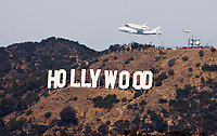 The Shuttle Endeavor as it flies past the Hollywood sign in Los Angeles, CA.  September 21,  2012. Photo by David Sprague