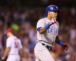 September 27, 2017 - St. Louis, MO, USA - The Chicago Cubs' Addison Russell reacts after he hit a three-run home run off of St. Louis Cardinals starting pitcher Michael Wacha, background, in the seventh inning on Wednesday, Sept. 27, 2017, at Busch Stadium in St. Louis. The Cubs clinched the N.L. Central Division title with a 5-1 victory. (Credit Image: © Chris Lee/TNS via ZUMA Wire)
