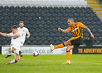 Hull City's Josh Magennis shot is blocked by Oxford United's Cameron Brannagan<br /> <br /> Photographer Lee Parker/CameraSport<br /> <br /> The EFL Sky Bet League One - Hull City v Oxford United - Saturday 13th March 2021 - KCOM Stadium - Kingston upon Hull<br /> <br /> World Copyright © 2021 CameraSport. All rights reserved. 43 Linden Ave. Countesthorpe. Leicester. England. LE8 5PG - Tel: +44 (0) 116 277 4147 - admin@camerasport.com - www.camerasport.com