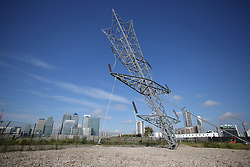 © Licensed to London News Pictures. 17/09/2015. London, UK. A 35 metre sculpture by artist Alex Chinneck entitled 'A bullet from a shooting star' depicting an inverted electricity pylon is unveiled on Greenwich Peninsula. Photo credit: Peter Macdiarmid/LNP