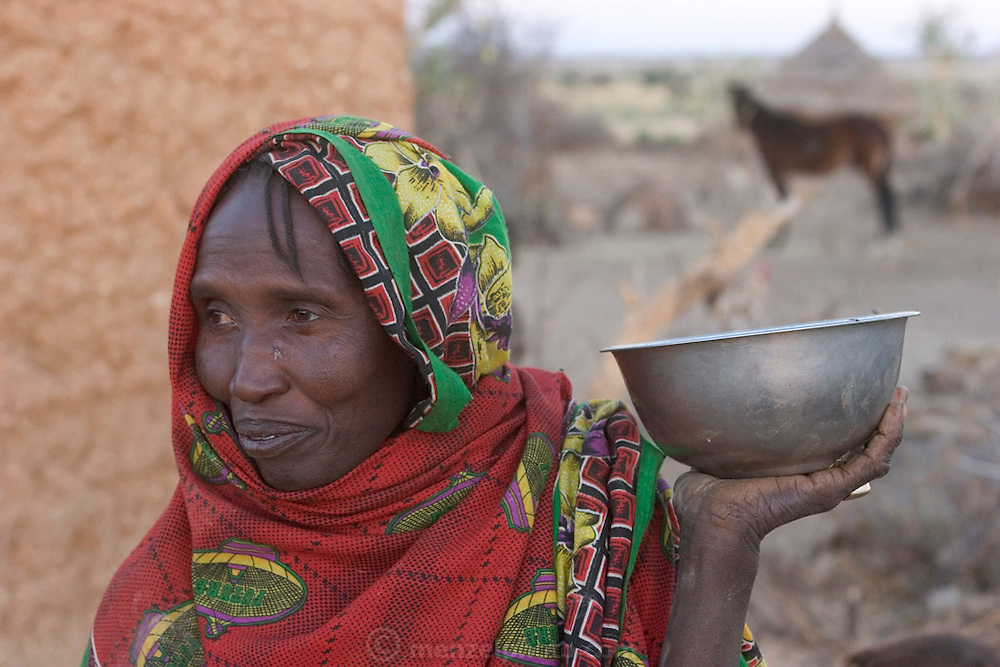 In Dar es Salaam village, eastern Chad, Khadidja Baradine, 42, has just milked a small bowl of milk form their cow. (Supporting image from the project Hungry Planet: What the World Eats.).