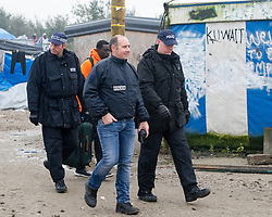 October 24, 2016 - Calais, Northern France, France - Image ¬©Licensed to i-Images Picture Agency. 24/10/2016. Calais, France. Calais Jungle Eviction. British police officers walk through the centre of the Calais Jungle. An estimated 3000 refugees and migrants to be processed and bussed out to reception centres across France. Picture by Pete Maclaine / i-Images (Credit Image: © Pete Maclaine/i-Images via ZUMA Wire)