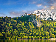 Medieval Bled Castle with the snowy apline peaks behind. Bled Slovenia.
