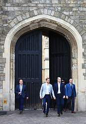 Prince Harry and Prince William step out of the Henry VIII Gate of Windsor Castle ahead of Prince Harry's wedding to Meghan Markle this weekend to meet members of the public.