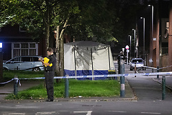 © Licensed to London News Pictures. 26/07/2020. Manchester, UK. A second forensic tent erected on Roseberry Street, approximately half a mile from the scene on Henbury Street. A 17 year old boy has been stabbed to death and three others stabbed causing injuries , in the Moss Side area of South Manchester this evening. Photo credit: Joel Goodman/LNP