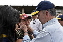April 2, 2017 - Mocoa, Colombia - Colombian President JUAN MANUEL SANTOS comforting a woman in Mocoa, capital city of Putumayo department. Santos declared a state of emergency in Mocoa, as a deadly mudslide has so far claimed 200 lives. (Credit Image: © Colombian Presidency/Xinhua via ZUMA Wire)