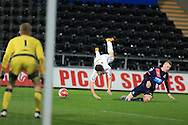 Dan James of Swansea city is fouled in the box by Newcastle's Callum Williams and a penalty is awarded.  U21 Barclays Premier league match, Swansea city U21's  v Newcastle Utd U21's at the Liberty Stadium in Swansea, South Wales on Monday 4th April 2016.<br /> pic by Andrew Orchard, Andrew Orchard sports photography.