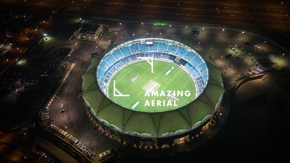DUBAI, UNITED ARAB EMIRATES - 23 February 2017 : Aerial view of the international cricket stadium during a competition at night in Dubai, United Arab Emirates.