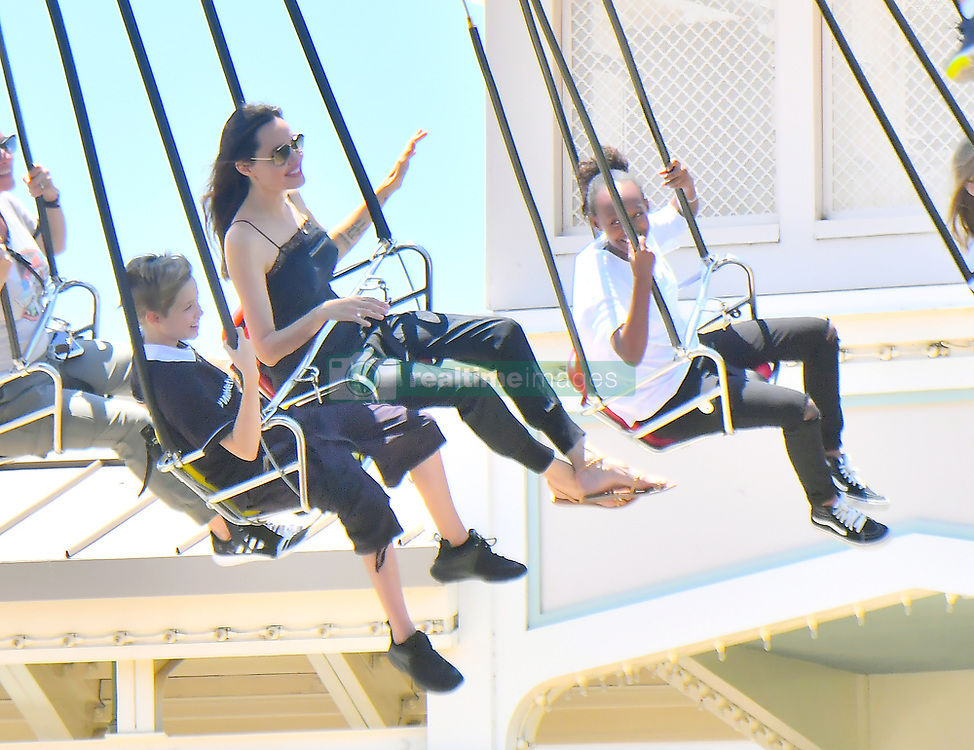 Angelina Jolie takes her kids to Disneyland to celebrate Knox and Vivian's birthday. 12 Jul 2017 Pictured: Angelina Jolie, Knox Jolie Pitt, Vivian Jolie-pitt, Zahara Jolie-pitt,. Photo credit: Snorlax / MEGA TheMegaAgency.com +1 888 505 6342