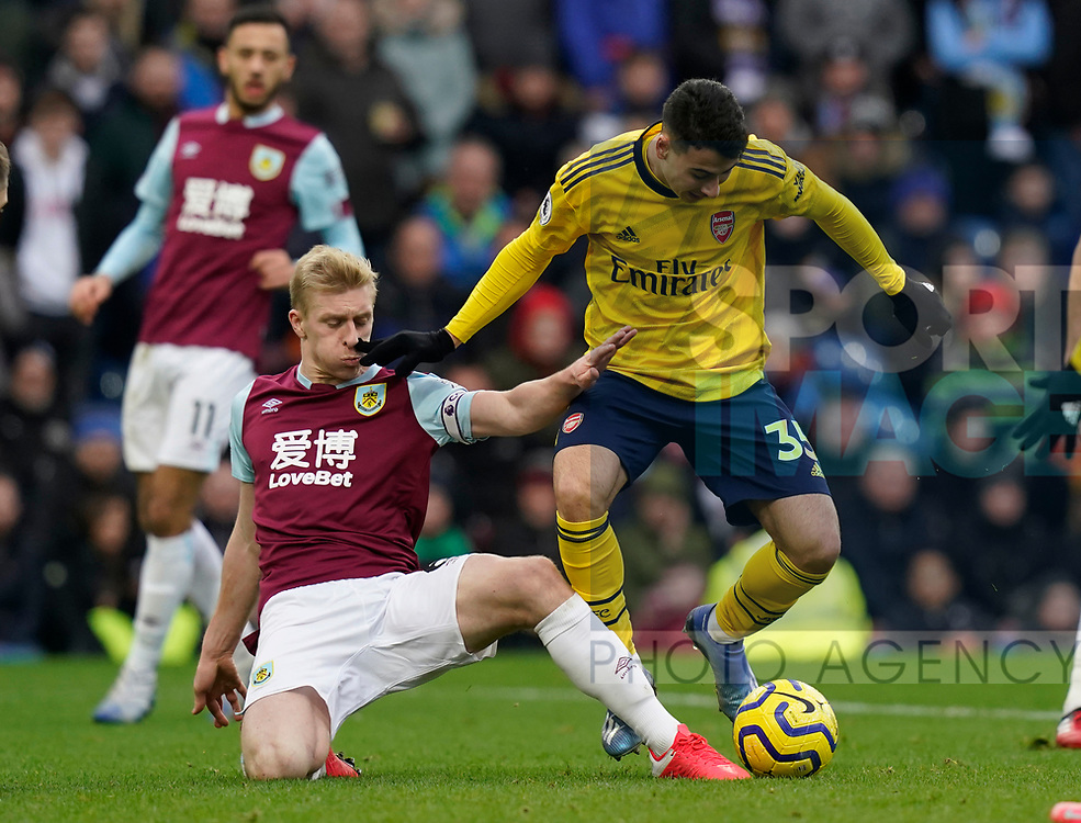 Ben Mee of Burnley tackles Gabriel Martinelli of Arsenal during the Premier League match at Turf Moor, Burnley. Picture date: 2nd February 2020. Picture credit should read: Andrew Yates/Sportimage