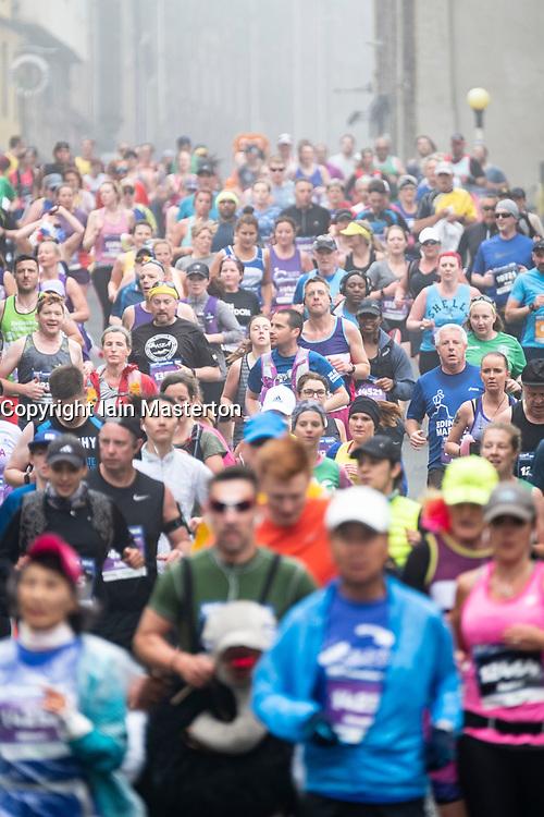 Edinburgh, Scotland, UK. 27 May, 2018. Runners make their way down the Royal Mile towards the Scottish Parliament Building at Holyrood during the Edinburgh Marathon 2018