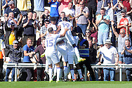 Mansfield players celebrates as they  jump on  goalscorer Kevan Hurst (in huddle) after he scores a last gasp winner, his teams 3rd goal. Skybet EFL league two match, Newport county v Mansfield Town at Rodney Parade in Newport, South Wales on Saturday 6th August 2016.<br /> pic by Carl Robertson, Andrew Orchard sports photography.