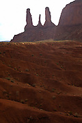 View of the Three Sisters in Monument Valley on the southern border of Utah with northern Arizona. The valley lies within the range of the Navajo Nation Reservation. The Navajo name for the valley is Tsé Bii' Ndzisgaii - Valley of the Rocks.