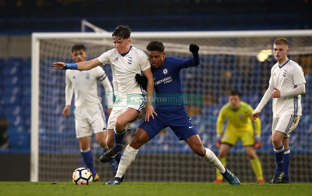 Birmingham City's Joe Redmond, battles for possession of the ball with Chelsea's Tino Anjorin