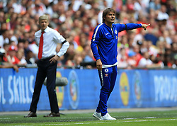 """Chelsea manager Antonio Conte and Arsenal manager Arsene Wenger on the touchline during the Community Shield at Wembley, London. PRESS ASSOCIATION Photo. Picture date: Sunday August 6, 2017. See PA story SOCCER Community Shield. Photo credit should read: Nigel French/PA Wire. RESTRICTIONS: EDITORIAL USE ONLY No use with unauthorised audio, video, data, fixture lists, club/league logos or """"live"""" services. Online in-match use limited to 75 images, no video emulation. No use in betting, games or single club/league/player publications."""