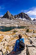 Hiker under Isosceles Peak in Dusy Basin, Kings Canyon National Park, California USA