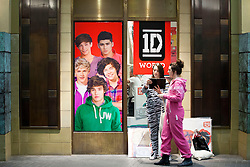 © Licensed to London News Pictures. 28/03/2013. London, UK. One Direction fans are seen leaving the 'One Direction World' pop-up shop which opened today (28/03/2013) at the O2 dome in Greenwich London today. Photo credit: Matt Cetti-Roberts/LNP