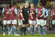 Referee Anthony Taylor in discussion with Gabriel Agbonlahor of Aston Villa before a Villa free-kick is taken. The FA cup, 6th round match, Aston Villa v West Bromwich Albion at Villa Park in Birmingham, Midlands on Saturday 7th March 2015<br /> pic by John Patrick Fletcher, Andrew Orchard sports photography.