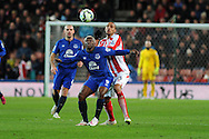 Arouna Kone  of Everton holds off Stoke city's Steven Nzonzi.   Barclays Premier League match, Stoke city v Everton at the Britannia Stadium in Stoke on Trent , Staffs on Wed 4th March 2015.<br /> pic by Andrew Orchard, Andrew Orchard sports photography.