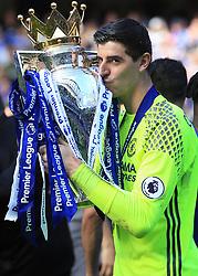 21 May 2017 - Premier League - Chelsea v Sunderland - Chelsea goalkeeper Thibaut Courtois celebrates kissing the Premier League trophy - Photo: Marc Atkins / Offside.