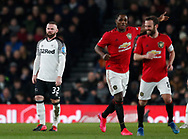 Odion Ighalo and Juan Mata of Manchester United laugh following the third goal as Wayne Rooney of Derby County looks on during the FA Cup match at the Pride Park Stadium, Derby. Picture date: 5th March 2020. Picture credit should read: Darren Staples/Sportimage