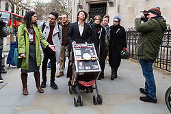 London - Alleged computer hacker Lauri Love arrives at the Royal Courts of Justice in London , pushing a mobile sound system playing electronic music, to find out whether he has successfully challenged a ruling that he can be extradited to the US, following allegations that he hacked United States government websites. PICTURED: Laurie love wheels his mobile sound system towards the court. February 05 2018.