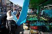 Street market selling fruit and vegetables along the Ladypool Road in Sparkbrook, Birmingham, England, United Kingdom. This area is predominantly inhabited by Asian families. Sparkbrook has the second highest non-white population in Birmingham, with minority ethnic residents living in the area; notably it is home to a large Somali population. Sparkbrook is also the location of Birminghams Balti Triangle, as many of the residents have their own balti businesses.