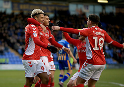 Charlton Athletic's Lyle Taylor celebrates with team-mates Karlan Grant and Albie Morgan after he scores his sides first goal.