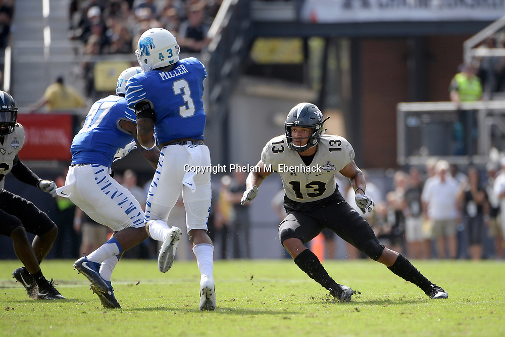 Central Florida defensive back Bryon Brown (13) defends as Memphis wide receiver Anthony Miller (3) catches a pass during the first half of the American Athletic Conference championship NCAA college football game Saturday, Dec. 2, 2017, in Orlando, Fla. (Photo by Phelan M. Ebenhack)