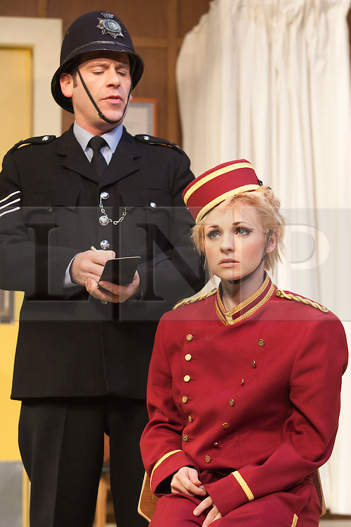 © Licensed to London News Pictures. 09/05/2012. London, England. Georgia Moffett as Geraldine Barclay and Jason Thorpe as Sergeant Match. What the Butler Saw by Joe Orton and directed by Sean Foley opens at the Vaudeville Theatre, London. Photo credit: Bettina Strenske/LNP