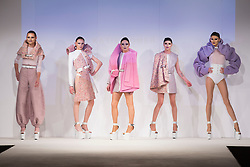 © Licensed to London News Pictures. 30/05/2015. London, UK. A model walks the runway during the Ravensbourne fashion show at Graduate Fashion Week 2015 wearing the Drag Queen collection of graduate student Katie Homer. Graduate Fashion Week takes place from 30 May to 2 June 2015 at the Old Truman Brewery, Brick Lane. Photo credit : Bettina Strenske/LNP