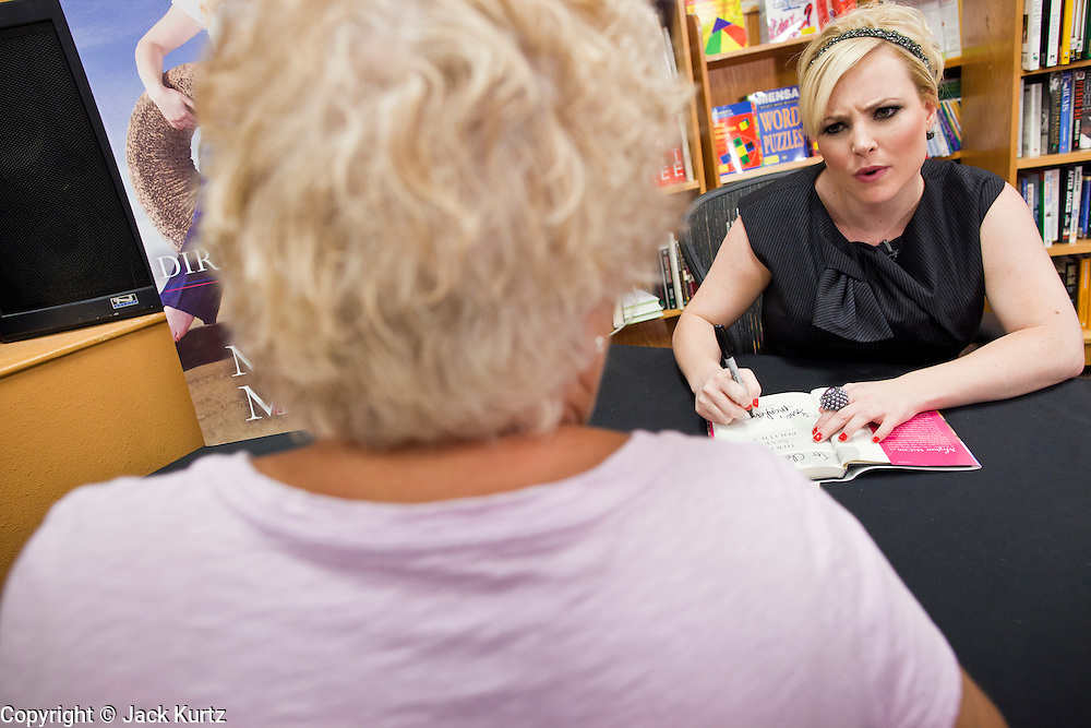 """Sept. 16 - TEMPE, AZ: MEGHAN MCCAIN signs copies of her book, """"Dirty Sexy Politics"""" at Changing Hands Bookstore in Tempe, AZ, Thursday, Sept. 16. McCain's book is a recounting of her life on the campaign trail during the 2008 election, when her father, John McCain, was the Republican candidate for President of the United States.  Photo by Jack Kurtz"""
